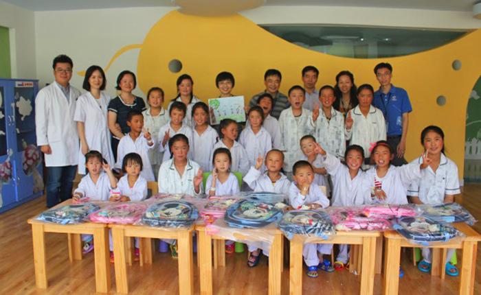 Group of volunteers with children receiving surgery